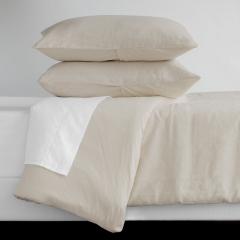 Как да се грижим за спалните комплекти от лен?